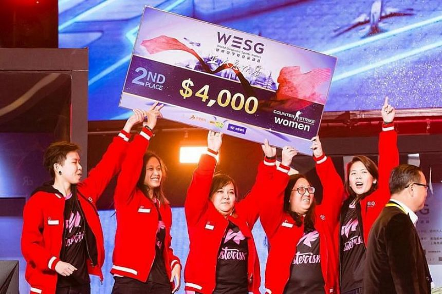 Asterisk celebrating after winning second place at the WESG APAC finals for the CS:GO women's division.