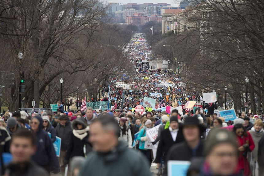 Pro-life demonstrators marching towards the US Supreme Court during the 44th annual March for Life in Washington, DC, on Jan 27, 2017.