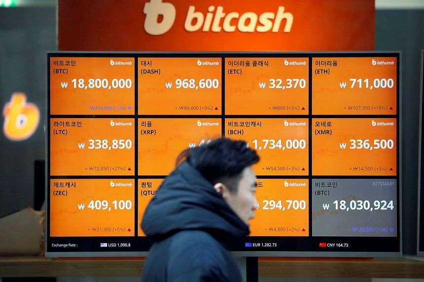 An electric board showing exchange rates of various cryptocurrencies including Bitcoin at a cryptocurrencies exchange in Seoul on Dec 13, 2017.