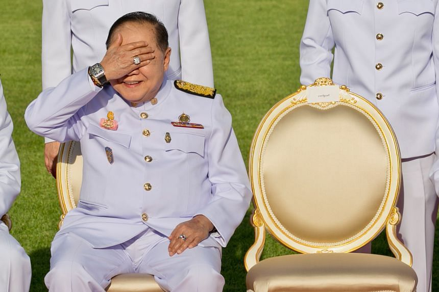 Thailand's Deputy Prime Minister Prawit Wongsuwan, displaying a watch he is wearing, during a photo call with other members of a new cabinet in Bangkok on Dec 4, 2017.