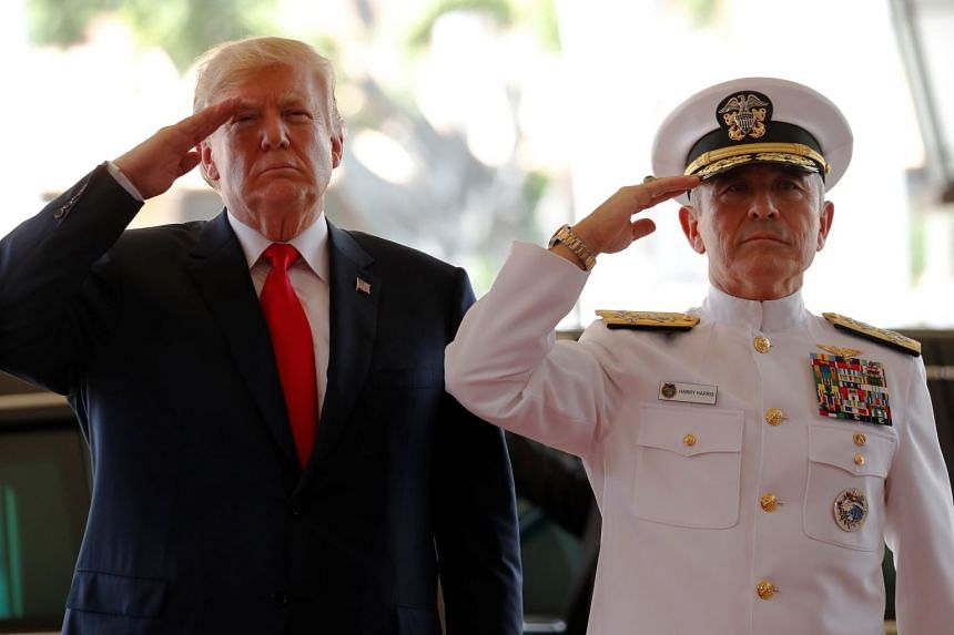 US Navy Admiral Harry Harris, commander of United States Pacific Command, welcoming US President Donald Trump at its headquarters in Aiea, Hawaii, on Nov 3, 2017.