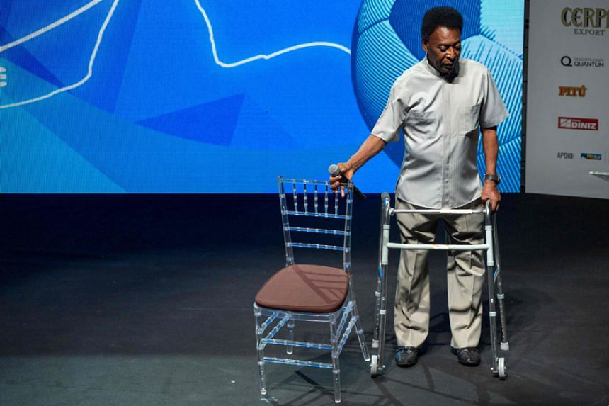 Pele uses a walking frame to stand on stage during the opening event of the 2018 Carioca Football Championship at Cidade das Artes in Rio de Janeiro on Jan 15.