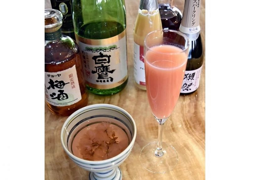 A sake-based cocktail with pickled cherry blossom (left) and a sparkling sake cocktail with peach juice at the Keio Plaza Hotel Tokyo in Nishishinjuku, Tokyo.