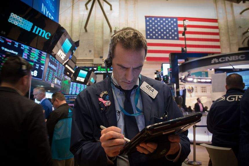 Traders work on the floor at the New York Stock Exchange on Jan 17, 2018.