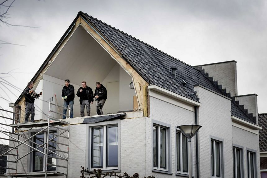 The side wall of a house was blown away by the storm in De Meern, The Netherlands, on Jan 18, during the second western storm of the year.