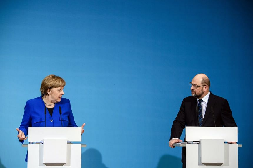 Social Democratic Party leader Martin Schulz has urged members to endorse coalition talks with Chancellor Angela Merkel's conservatives.