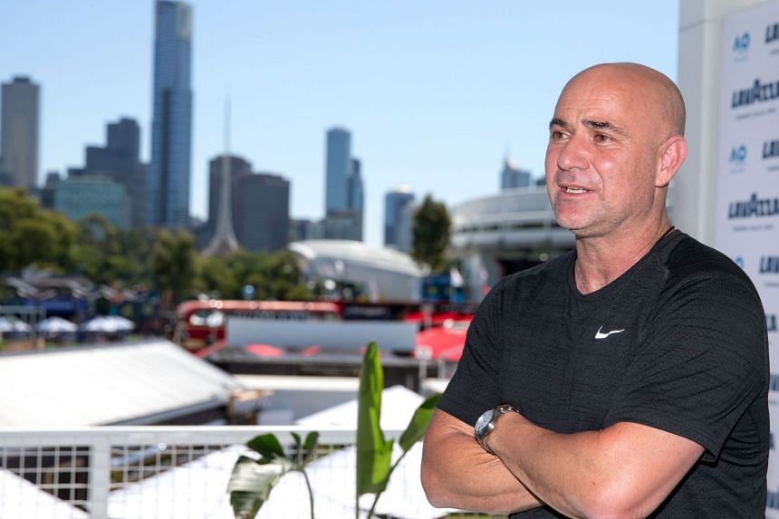 Novak Djokovi's mentor Andre Agassi speaks during an official event promoting the Australian Open tennis tournament at the Grand Slam Oval in Melbourne on Jan 19, 2018.