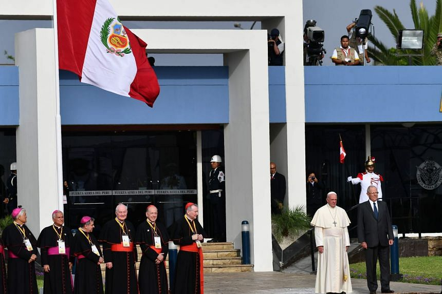 Pope Francis is welcomed by Peruvian President Pedro Pablo Kuczynskiand Peruvian bishops on arrival at an air force base in Lima on Jan 18.
