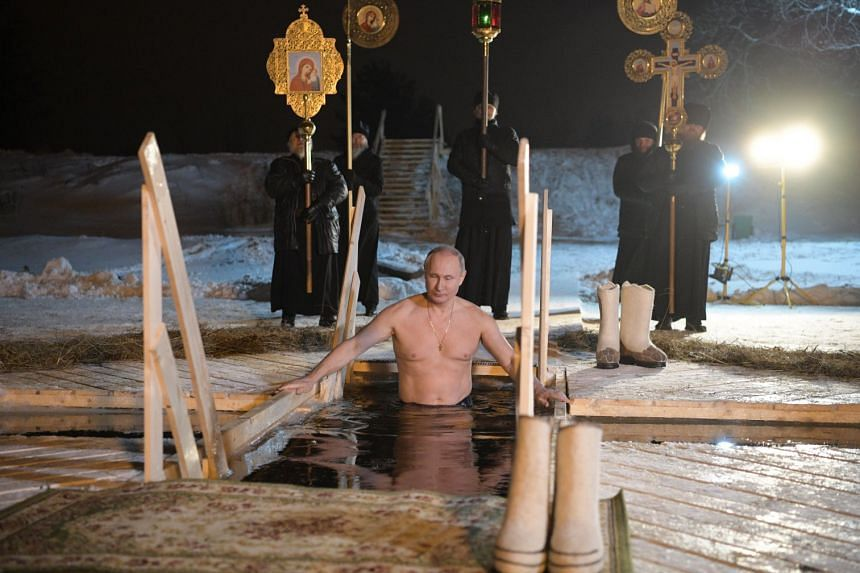 Russian President Vladimir Putin taking a dip in Lake Seliger during the celebrations of the Epiphany Orthodox holiday at the Nilov Monastery on Stolobny Island, Russia, on Jan 19.