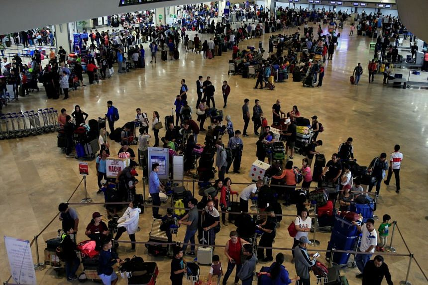 Passengers wait for flights inside the Ninoy Aquino International Airport. The airport said it would not renew the operating licence of ground handling service MIASCOR after complaints were lodged over stolen items from luggages.