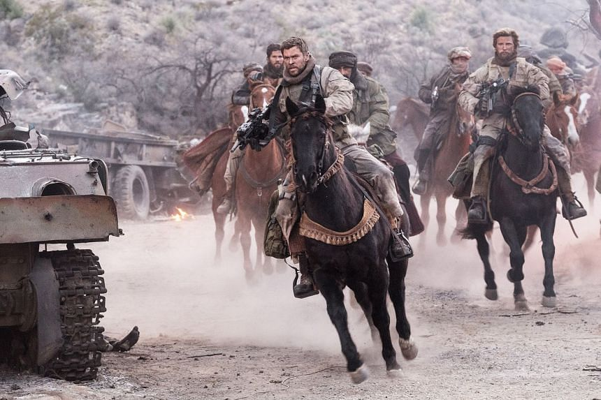 Chris Hemsworth (centre) as Special Forces captain Mitch Nelson in war drama 12 Strong.