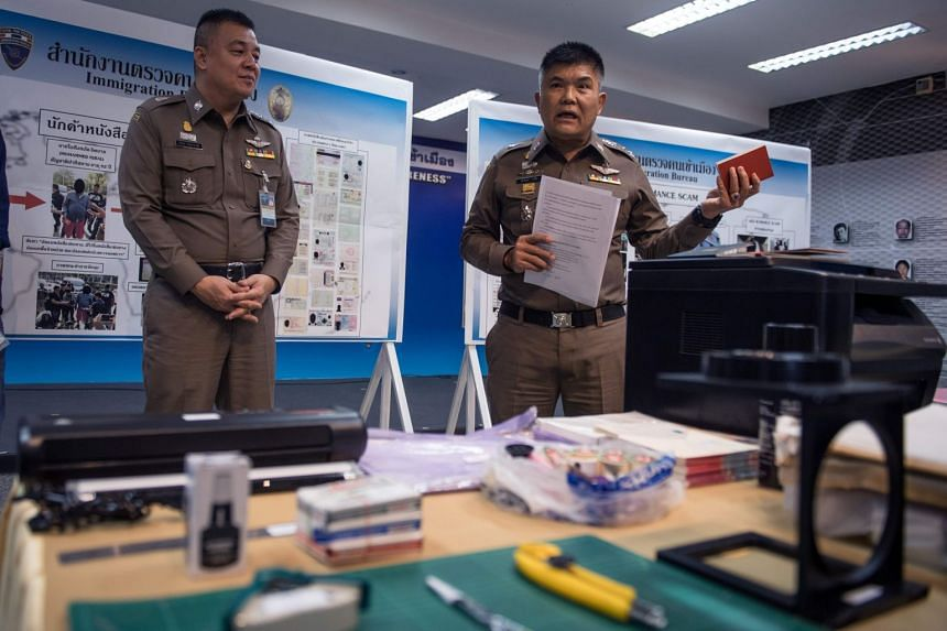Commander of the Immigration Bureau Lieutenant General Suttipong Vongpint (right) said the forger was working on faking documents for a long time.