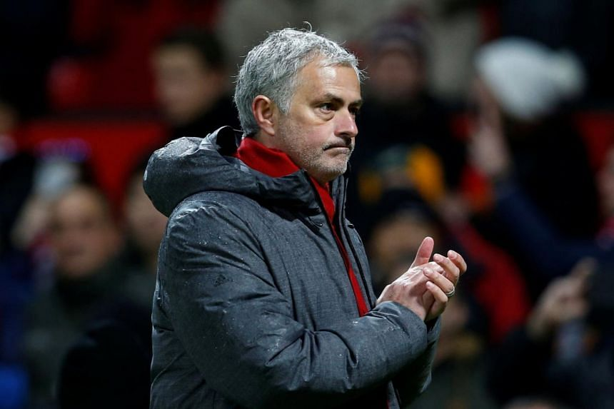 Manchester United manager Jose Mourinho applauds fans after his team's match with Stoke City on Jan 15, 2018.
