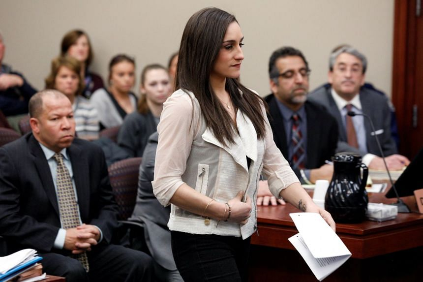 Victim and former gymnast Jordyn Wieber walks to the podium to speak at the sentencing hearing for Larry Nassar.