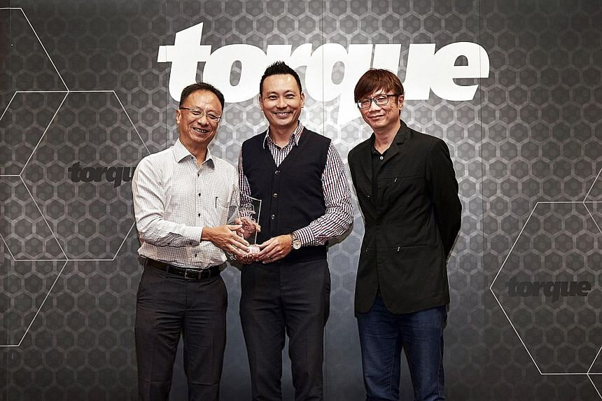 The Straits Times Car of the Year 2017 - Lexus LC500 (From far left) Torque consulting editor Christoper Tan, marketing director of Borneo Motors Samuel Yong and Torque editor David Ting. Best Family Saloon - Renault Megane Sedan Best Seven-seater SU