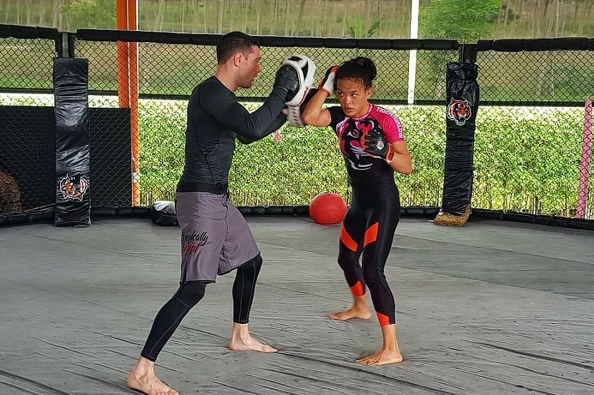 Tiffany Teo sparring with a coach at the TMT gym in Chalong, Phuket. Her One Championship strawweight title bout opponent tonight, China's Xiong Jingnan, was training at the PTT gym along the same street about 1km away.