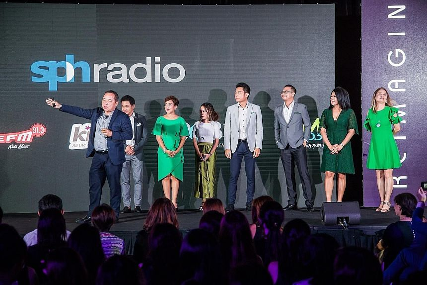 (From left) SPH Radio general manager Sim Hong Huat with DJs Desmond Wong and Claressa Monteiro, morning show producers Nadirah Zaidi and Ryan Huang, DJs Elliott Danker and Yasmin Jonkers, and Money FM 89.3's assistant programme director Loretta Lope