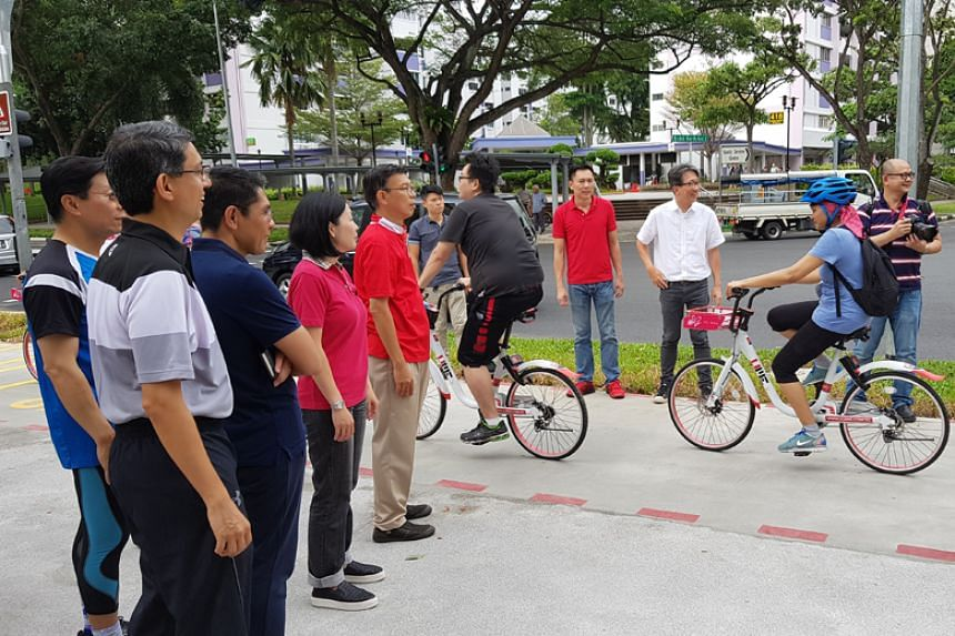 East Coast GRC MPs welcoming cyclists along the newly opened cycling network in Bedok.