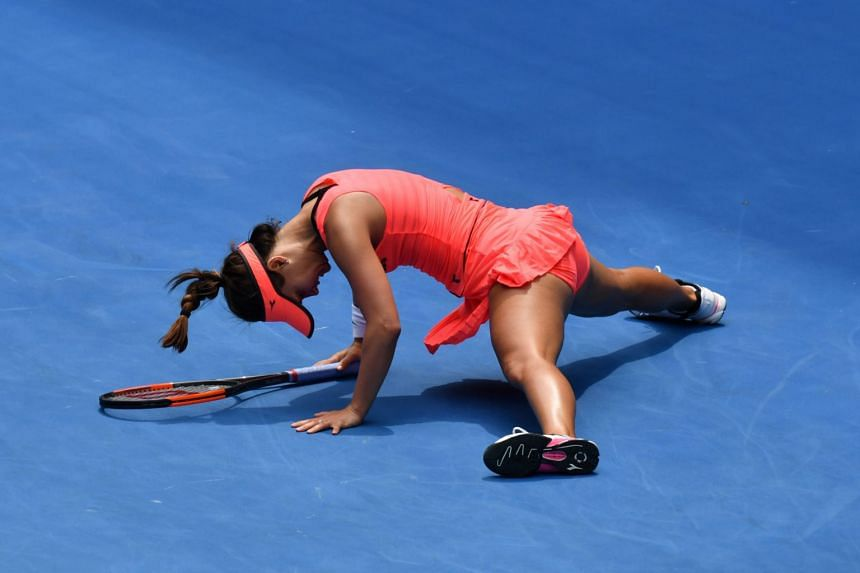 Lauren Davis of the US falls during their women's singles third round match against Romania's Simona Halep on day six of the Australian Open in Melbourne on Jan 20.