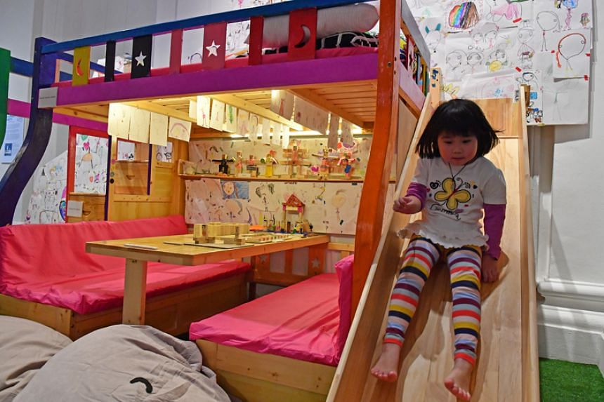 "An installation by Rinn Chan, five, which features a bed and slide and more than 100 drawings of a character called Emma, is one of the artworks at the ""Is Anyone Home?"" exhibition."
