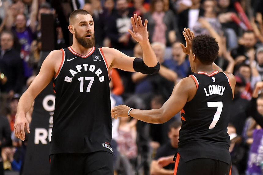 Toronto Raptors guard Kyle Lowry and centre Jonas Valanciunas celebrate scoring a basket against San Antonio Spurs during the second half of the NBA match at Air Canada Centre on Jan 19.