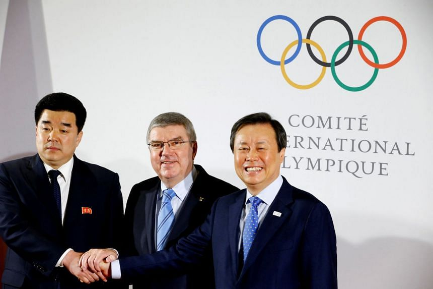 (From left) Mr Kim Il Guk, president of North Korea's National Olympic Committee, IOC chief Thomas Bach and South Korean Minister of Culture, Sports and Tourism Jong Hwan Do at the IOC headquarters in Lausanne, Switzerland, on Jan 20, 2018.