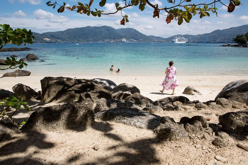 Blockchain Cruise guests relaxing on Paradise Beach as their cruise ship sat offshore in Phuket, Thailand, on Wednesday.