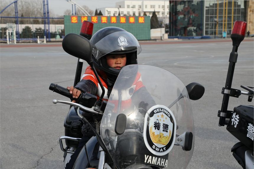 Wang Fuman visited Beijing's anti-terror and Special Forces unit during his stay in the city.