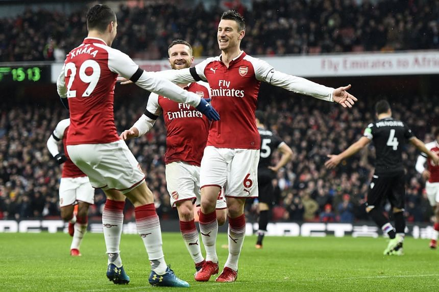 Arsenal's Laurent Koscielny (right) celebrates with team mate Granit Xhaka (left) after scoring against Crystal Palace.