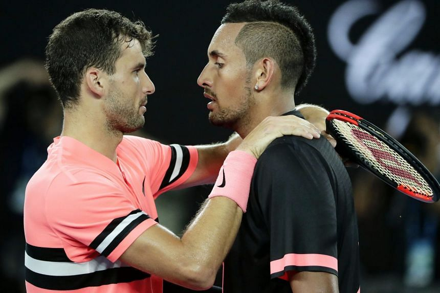 Grigor Dimitrov (left) of Bulgaria and Nick Kyrgios of Australia meeting at the net after their fourth-round match at the Australian Open on Jan 21, 2018. Third seed Dimitrov won in four sets.