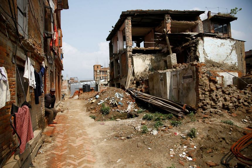 Abandoned houses, damaged during the 2015 earthquake, stand in Bhaktapur, Nepal, on April 21, 2017.