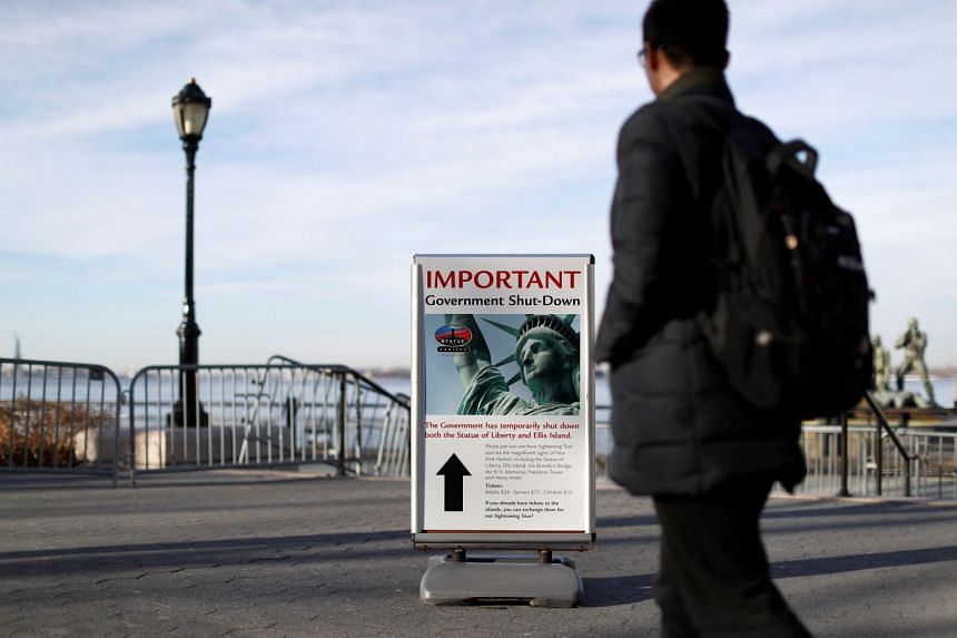 A sign announcing the closure of the Statue of Liberty sits near the ferry dock to the Statue of Liberty at Battery Park in Manhattan.