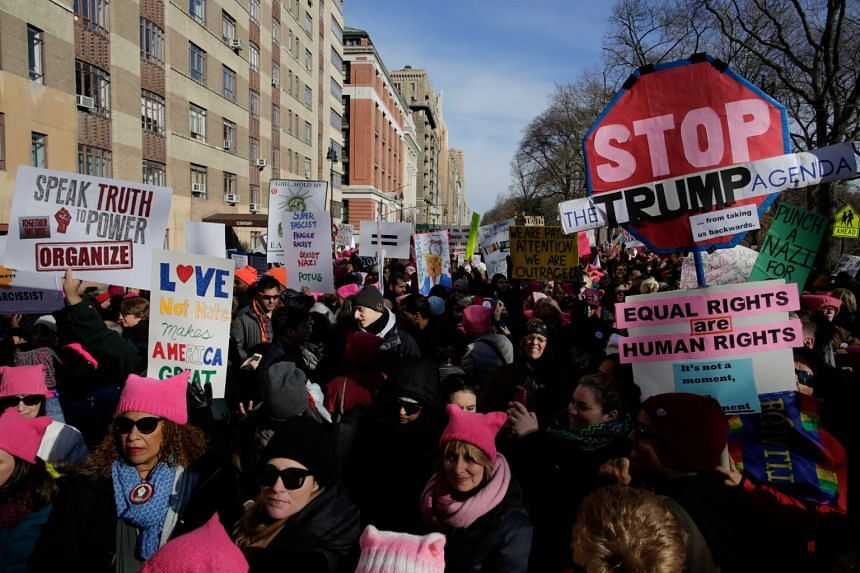 People take part in the Women's March in Manhattan in New York City.