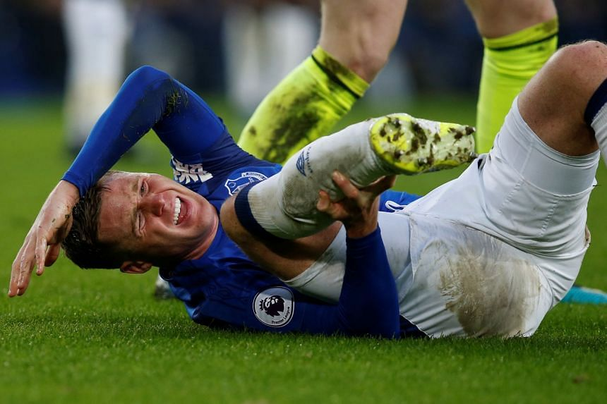 Everton's James McCarthy reacts after sustaining an injury in a challenge with West Brom's Salomon Rondon.