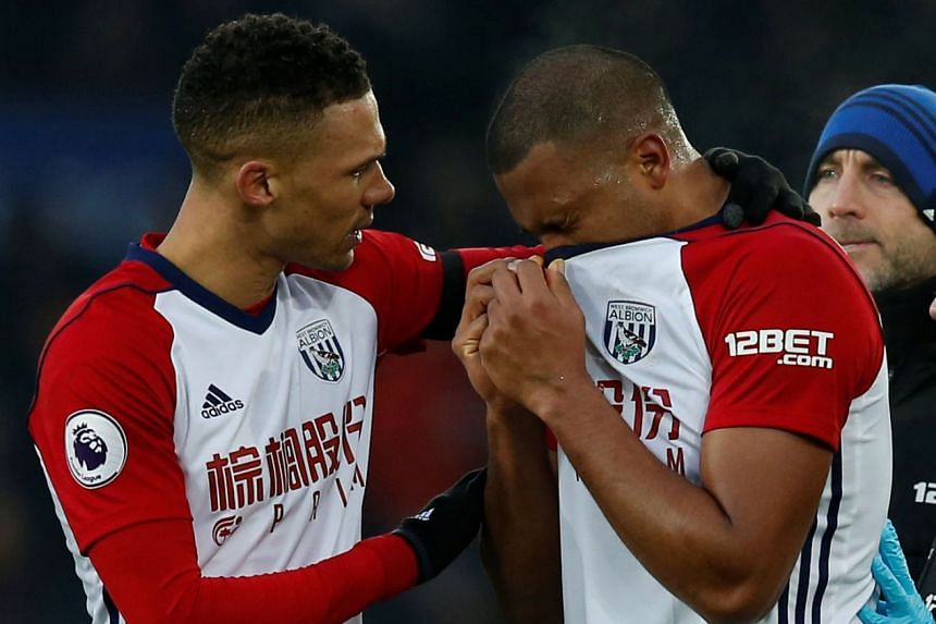 West Brom's Kieran Gibbs consoles Salomon Rondon after his challenge led to McCarthy's injury.