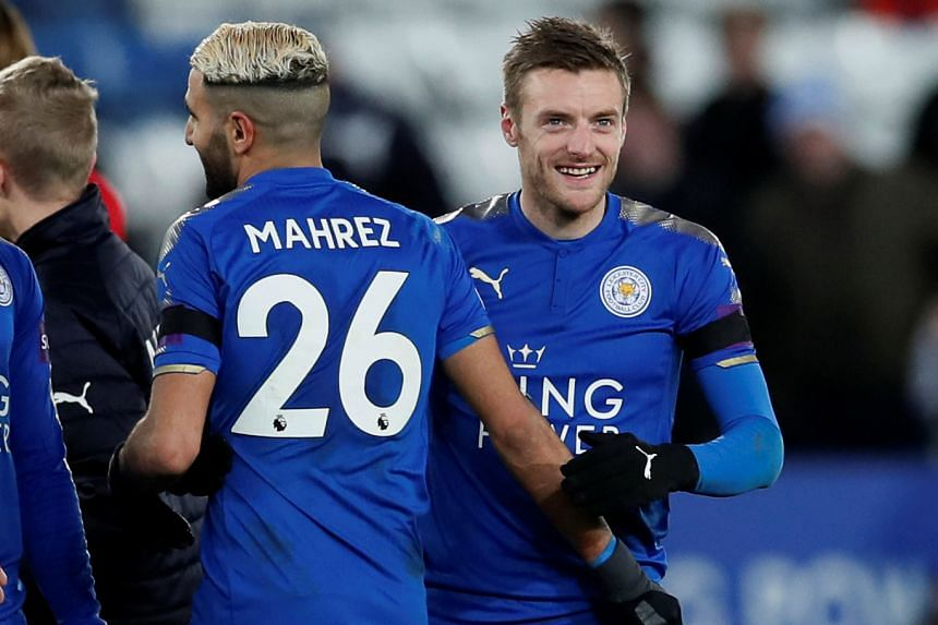 Leicester City's Jamie Vardy and Riyad Mahrez celebrate after the match.
