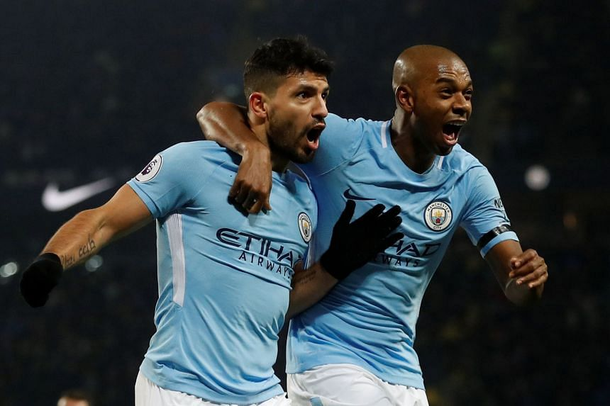 Manchester City's Sergio Aguero celebrates scoring their third goal and completing his hat-trick with Fernandinho.