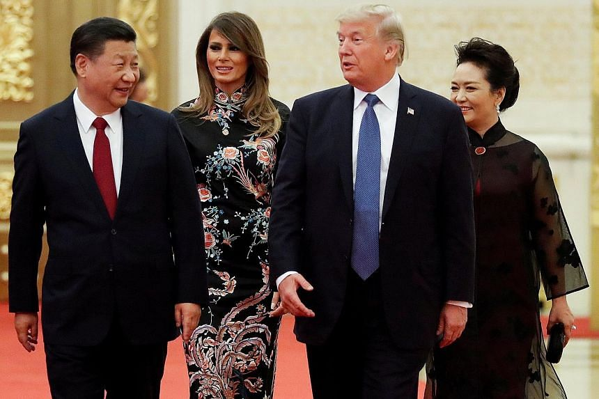 Above: US President Donald Trump and his wife Melania arriving for the state dinner with China's President Xi Jinping and First Lady Peng Liyuan at the Great Hall of the People in Beijing last November. Left: Mr Trump with (from far left) Vietnam Pri
