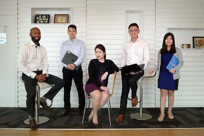 Members of the team that investigated the five Japanese electronics manufacturers (from left): Team supervisor and CCS enforcement division director Harikumar Sukumar Pillay, 40; lawyer Wong Chun Han, 28; lawyer and team leader Serene Seet, 37; econo