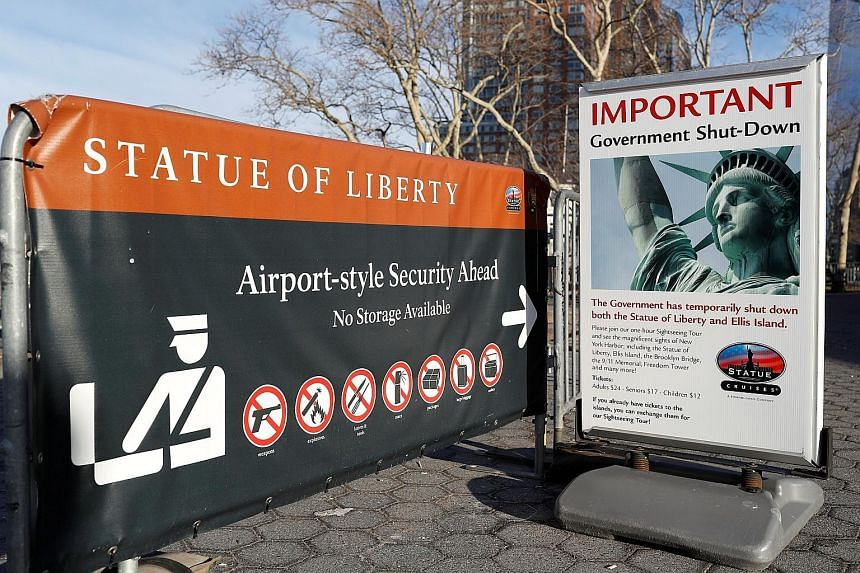 A sign near the ferry dock to the Statue of Liberty at Battery Park in Manhattan announcing the closure of the New York attraction as the government went into shutdown yesterday. Lawmakers were unable to pass a Continuing Resolution in time to avert