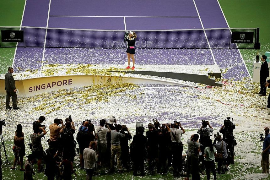 Denmark's Caroline Wozniacki celebrating with the trophy after winning last year's WTA Finals, which will be played here for the last time in October. SportSG began Tennis Week at last year's edition, which included fringe events and community engage