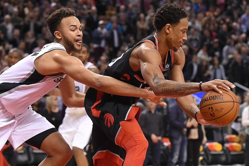 San Antonio guard Kyle Anderson tries to stop Toronto Raptors guard DeMar DeRozan at the Air Canada Centre on Friday. The hosts' solid defence proved key as they held on for a 86-83 win against the Spurs.