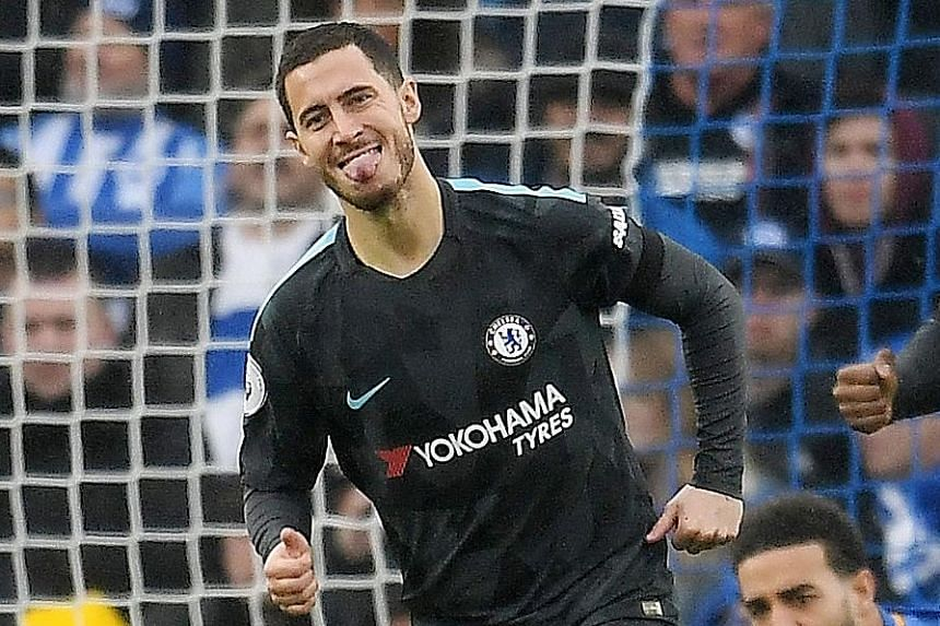 Chelsea forward Eden Hazard celebrating after his third-minute opener against Brighton yesterday. The Belgium international notched his 100th and 101st league goals with a brace in what was a virtuoso attacking performance.