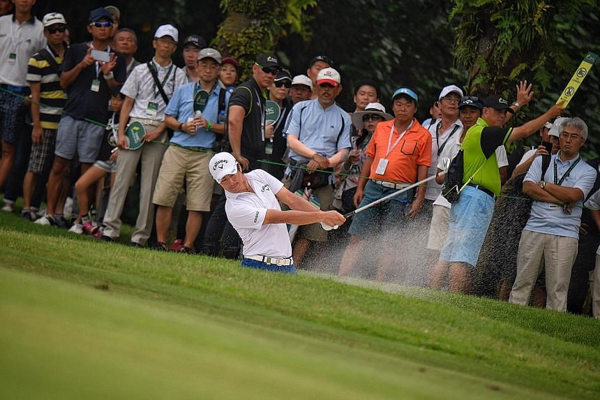 Japan's Ryo Ishikawa plays a bunker shot during the third round of the Singapore Open at Sentosa Golf Club's Serapong Course yesterday. Play was abandoned at 6.20pm due to lightning and will resume this morning.