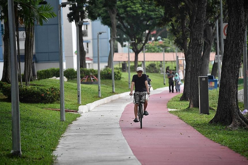 Designated bike lanes, like this one near Heartbeat@ Bedok, are painted red to distinguish them from regular footpaths, making Bedok the second town with such red lanes after Ang Mo Kio.
