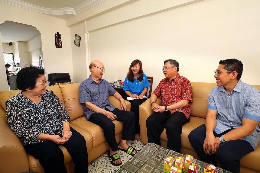 (From left) Madam Tan Siew Hong and her husband, Mr Low Kok Tee, who both have diabetes and are involved in the Health Peers Programme, chatting with CGH senior executive of strategic planning and development Valencia Lim, Health Minister Gan Kim Yon