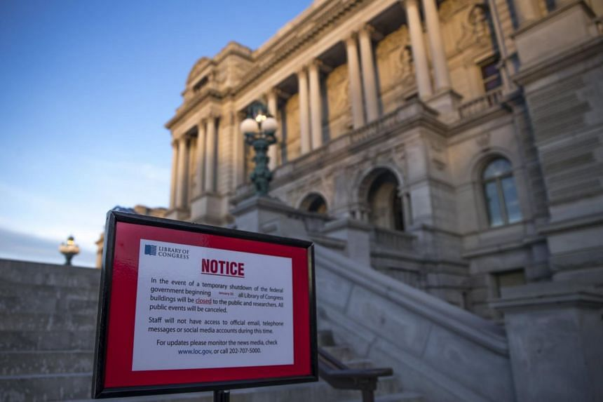 A closed sign in front of the Library of Congress as the Senate continues work on ending the government shutdown in the US Capitol in Washington, DC on Jan 20, 2018.