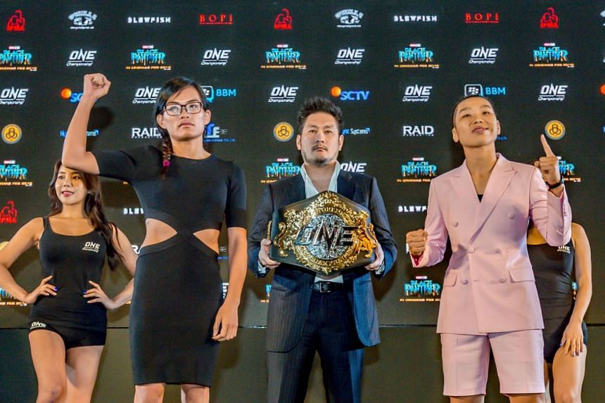 Singapore's Tiffany Teo (second left) and China's Xiong Jingnan (right) at the One Championship Kings of Courage press conference at the Fairmont Jakarta on Jan 18, 2018.