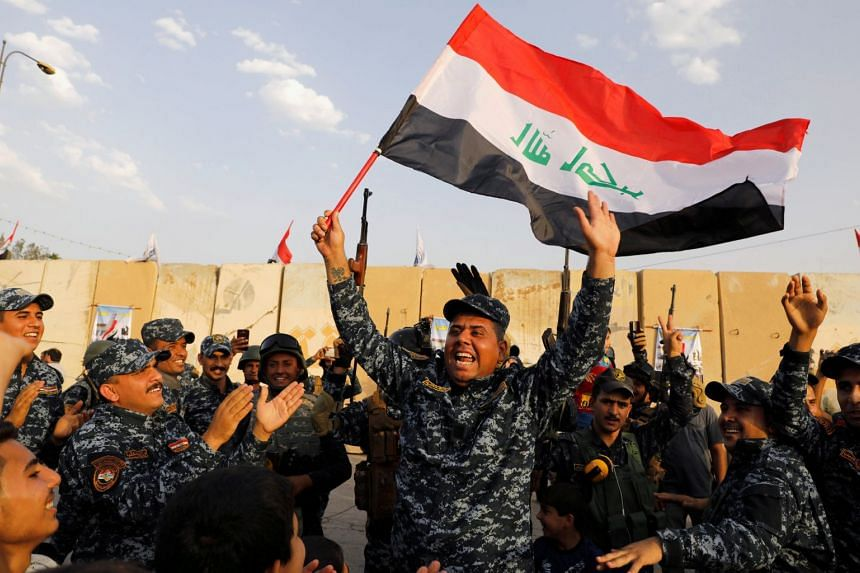 Iraqi Federal police officers celebrating the military victory of Iraqi forces over ISIS in Mosul, on July 2, 2017. A German ISIS member who was captured during the fall of Mosul has been sentenced to death by an Iraqi court.