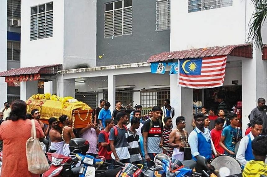 Mourners paying their final respects during the funeral of 15-year-old S. Sathiswaran, who was killed by a chair thrown from a block of flats, in Pantai Dalam, Kuala Lumpur, on Jan 18, 2018.
